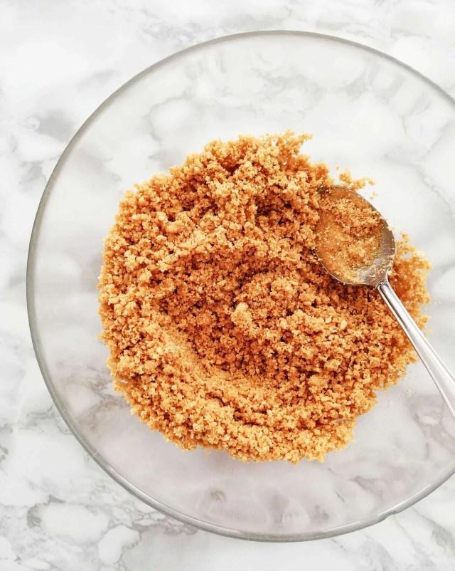 no bake fruit tart graham cracker crust mixture in bowl