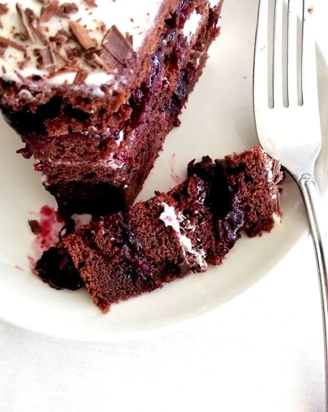 black forest cake piece taken off slice
