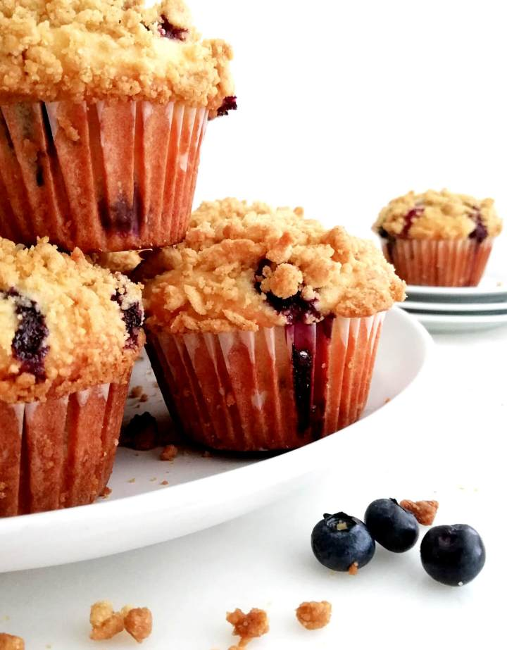 blueberry muffins with streusel topping in plate close up