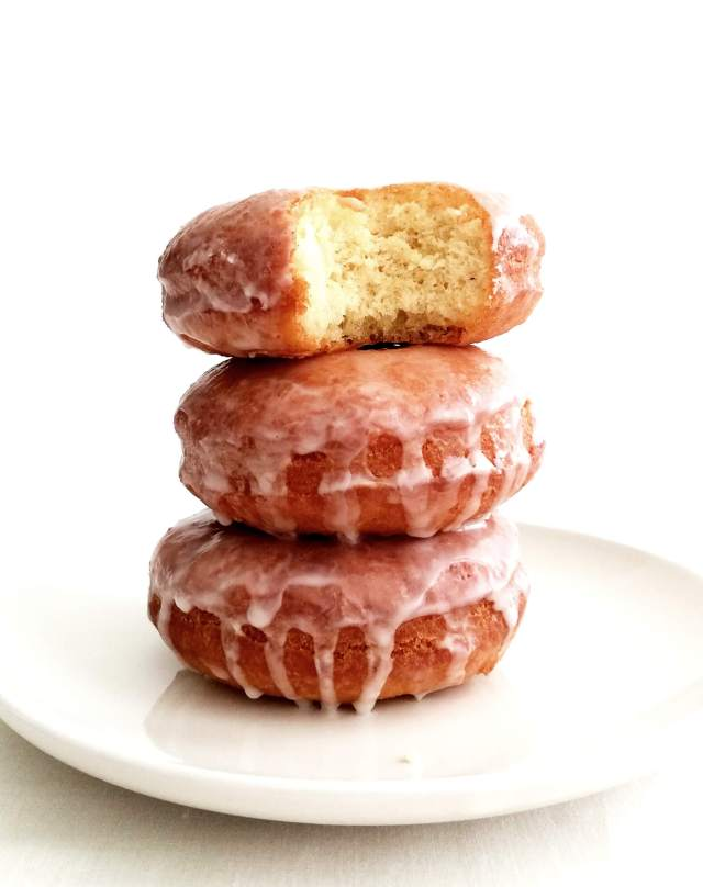 sour cream glazed donuts with bite missing from donut