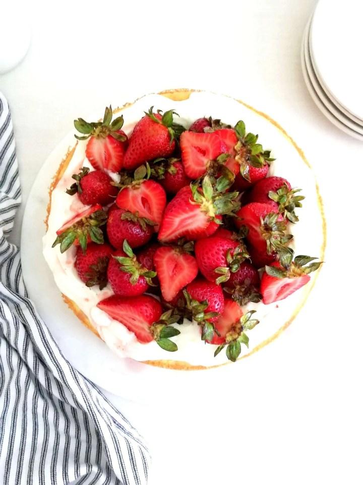 strawberry shortcake cake assembled overhead image