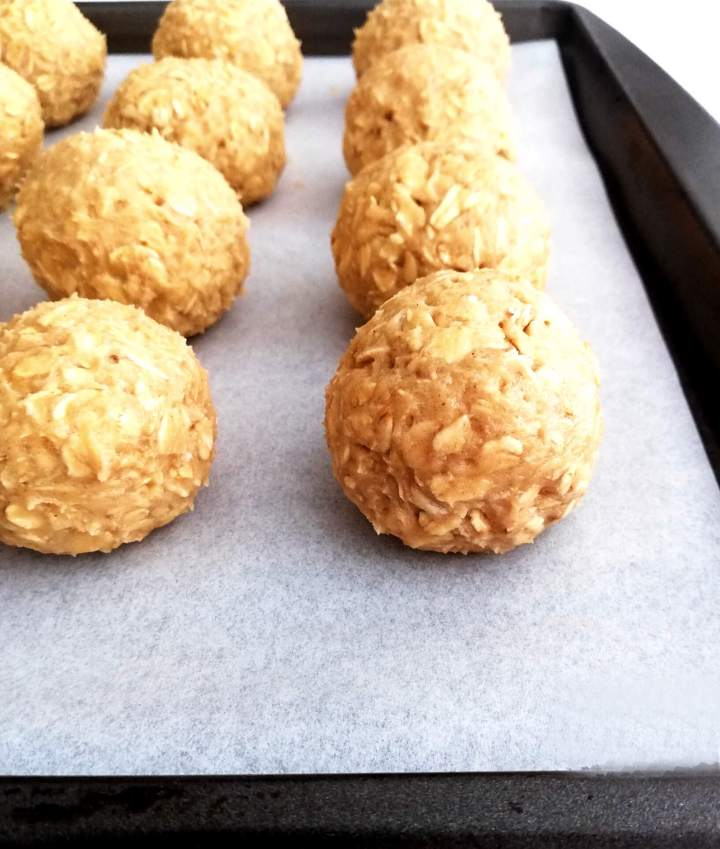 oatmeal cookie dough balls on baking sheet side view