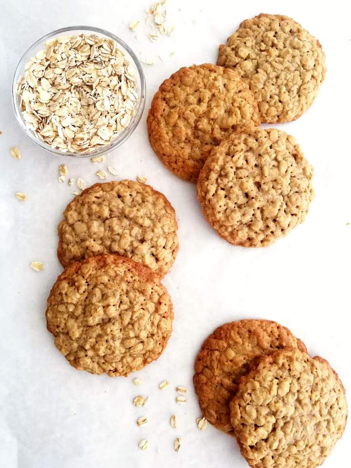 oatmeal cookies scattered on parchment paper overhead image