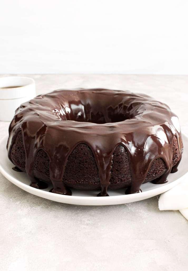 chocolate bundt cake topped with chocolate ganache quarter view