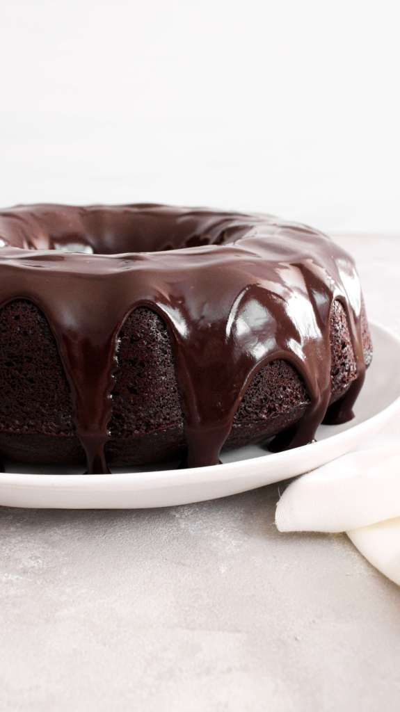 chocolate bundt cake topped with chocolate ganache side view