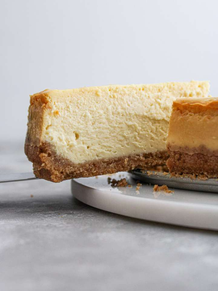 classic cheesecake taking slice out side view