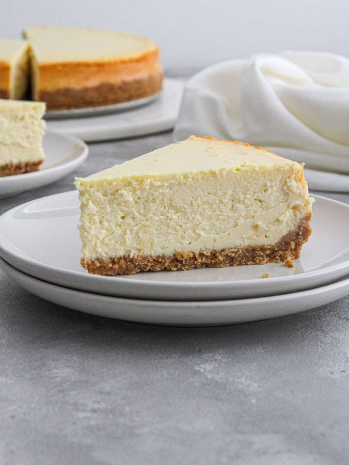 plain classic cheesecake slice in plate side view