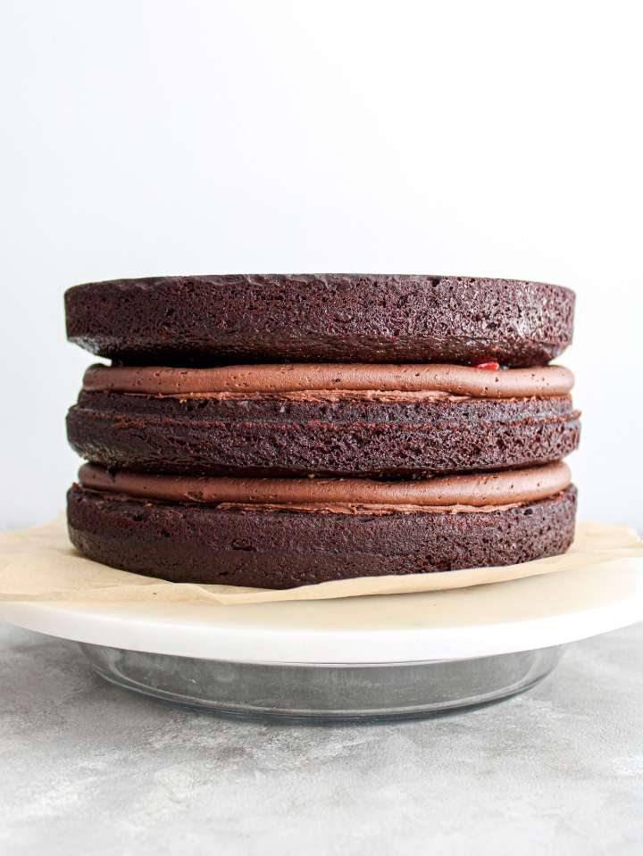 chocolate covered strawberry cake cake layers filled and stacked