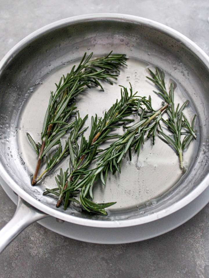 sugared cranberries and rosemary rosemary tossed in syrup