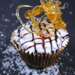 Salted Caramel Cupcakes | These paleo salted caramel cupcakes have a soft, airy texture without being overly sweet. Try your hand a sugar art for a fun decoration too! | eatsomethingdelicious.com