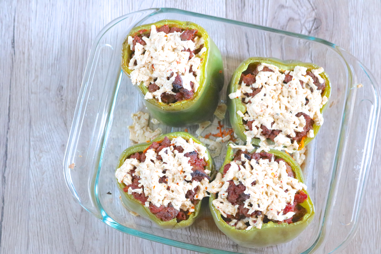 Spaghetti Stuffed Peppers | Spiralized sweet potato serves as gluten free noodles which are stuffed into green peppers, topped with meat sauce and optional cheese, then baked. | eatsomethingdelicious.com
