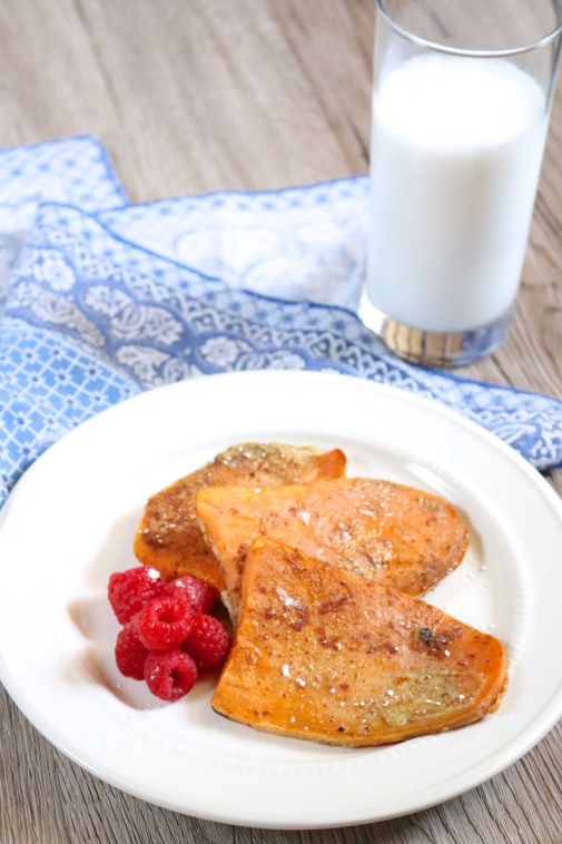 Sweet Potato French Toast | You no longer need to bake a loaf of bread from scratch to have paleo-friendly french toast. Sweet potato slices perfectly replace the bread in this recipe. | poshpaleo.com