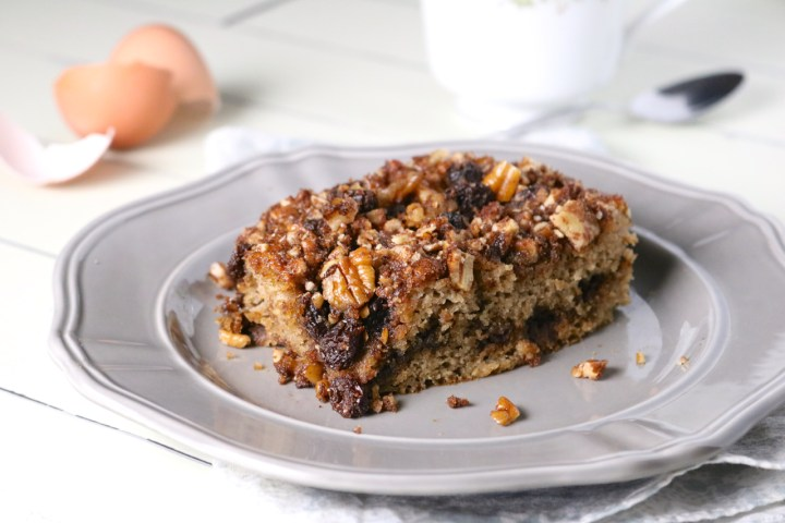 Cinnamon Raisin Coffee Cake | Cinnamon sugar, raisins, and pecans are baked between layers of soft vanilla bean spice cake. Only gluten free and paleo ingredients are used. | eatsomethingdelicious.com