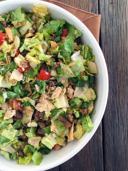 This is Kylie Walker from Kylie Walker Wellness bringing you my grain-free nacho chip taco salad, which is a perfect dish for summertime picnics and potlucks that is not only delicious but also nutritious.