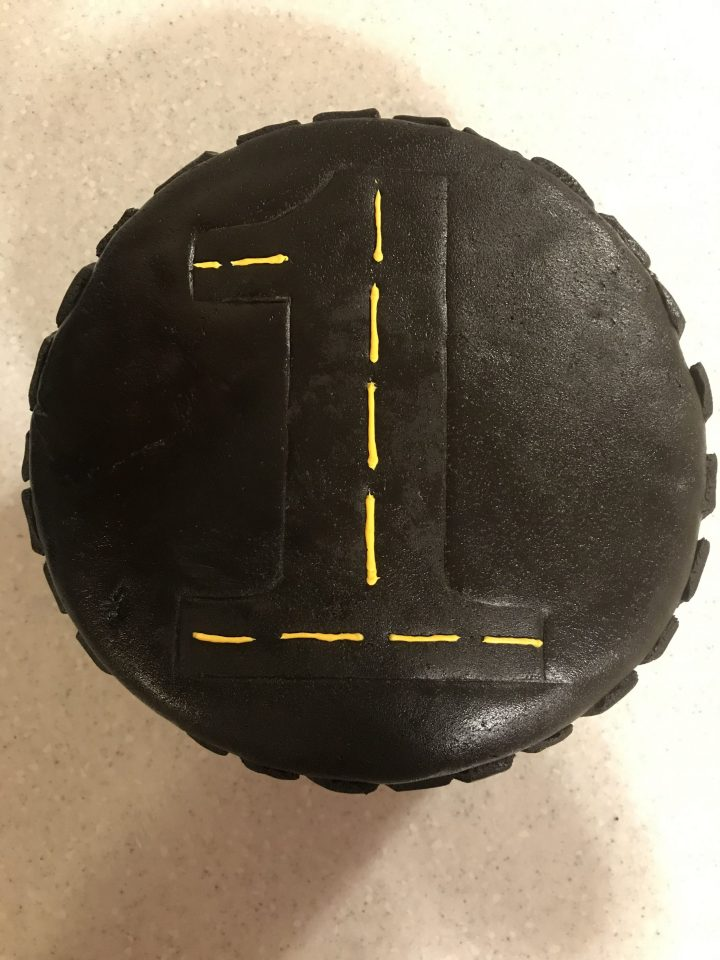 Allen's Tire Birthday Cake   Learn how to decorate a cake using only gluten free ingredients. I made this vanilla cake decorated in a tire tread pattern for my son's first birthday.   eatsomethingdelicious.com