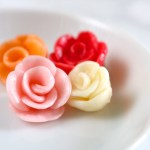 Starburst roses | Learn how to make roses out of Starburst candies. Use these Starburst roses as a replacement for buttercream roses on cakes and cupcakes. | eatsomethingdelicious.com