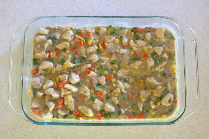 Creamy Chicken and Biscuits Casserole | A gluten free, dairy free version of creamy chicken and biscuits. A creamy, cheesy mixture of chicken, veggies, and corn are topped with bisuits and baked. | eatsomethingdelicious.com