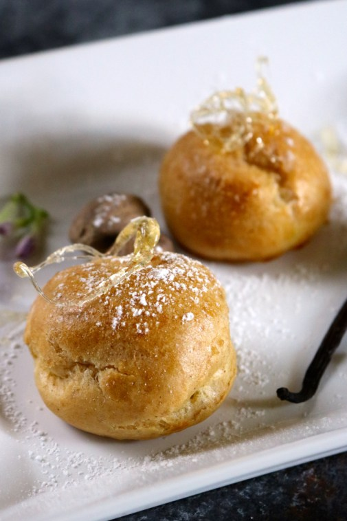 Vanilla Nutmeg Cream Puffs | Delicate golden cream puffs filled with a vanilla nutmeg custard. Although these are gluten free and dairy free, they are just as good as the original! | eatsomethingdelicious.com
