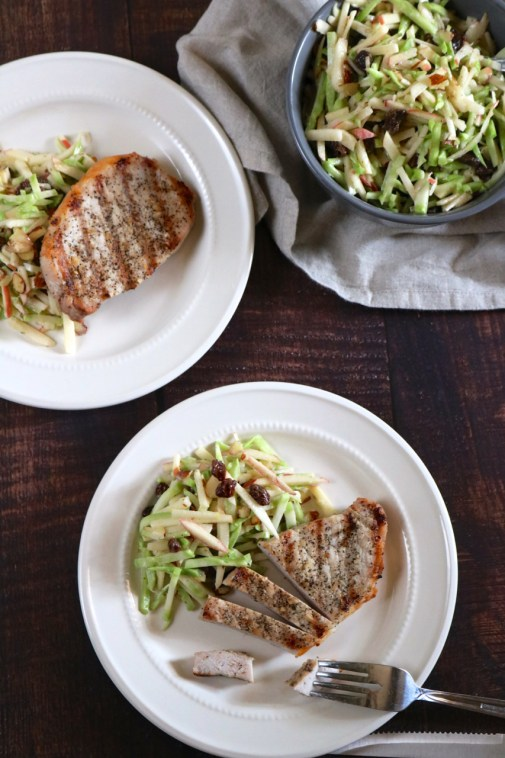 Garlic Pepper Pork Chops with Broccoli Apple Slaw | These grilled pork chops are a summery version of the classic pork and apple pairing where the apple is incorporated into a fresh broccoli slaw on the side. | eatsomethingdelicious.com