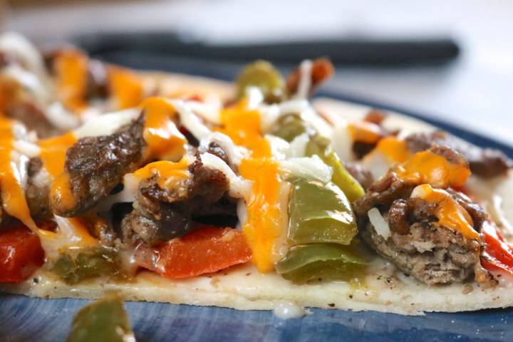 Cheesteak Pizza | Gluten free cheesesteak pizza made with 3 forms of dairy free cheese - simple cheesy white sauce, sprinkled with mozzarella, and drizzled with cheese sauce! | Eat Something Delicious