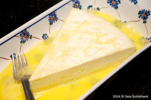 Coat the brie in egg wash