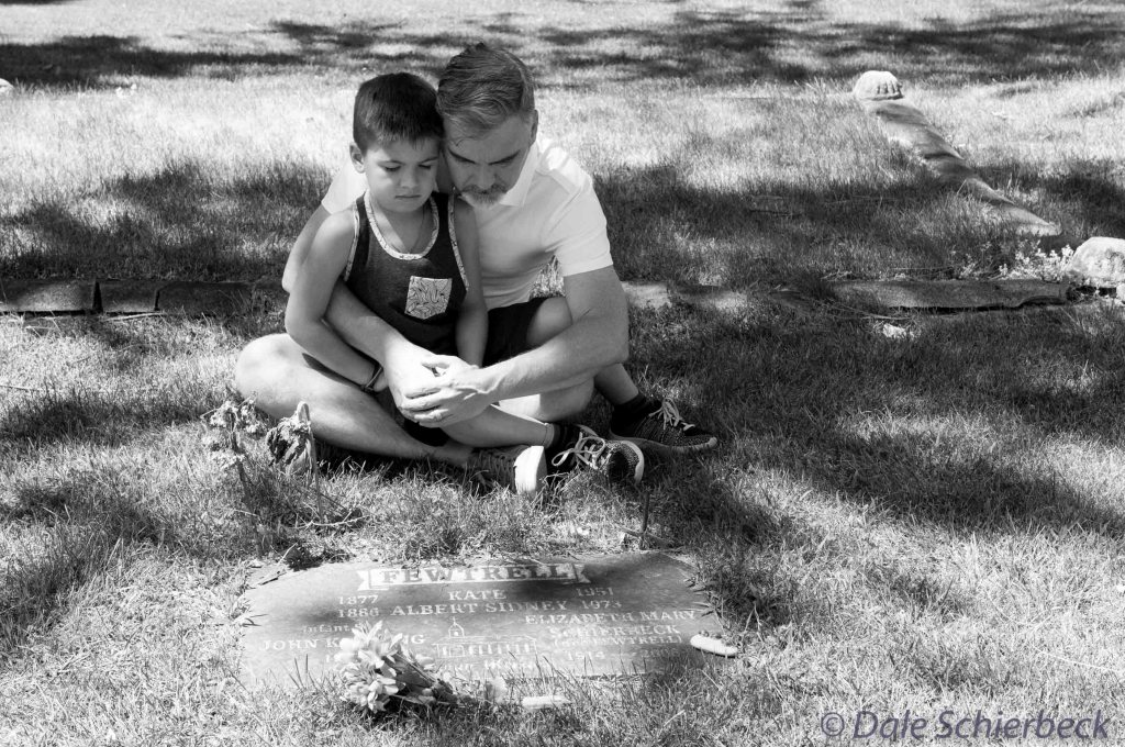 Father and Son at a Grave Site