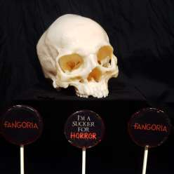 Three DIY Fangoria suckers in front of a sugar skull
