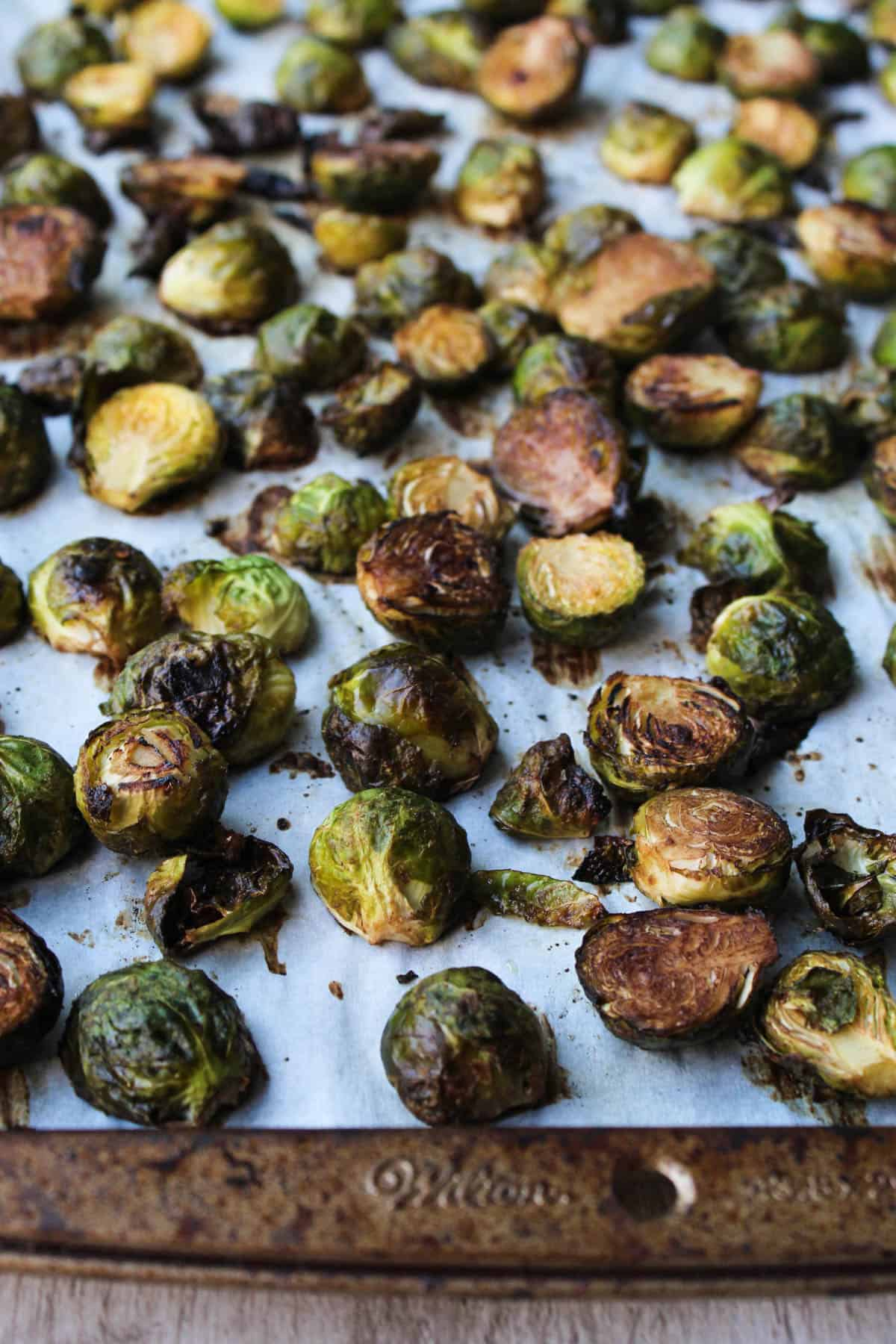 These Ginger & Balsamic Roasted Brussels Sprouts with Pomegranates are an easy & healthy side dish that are just as festive as the holiday season - Eat the Gains