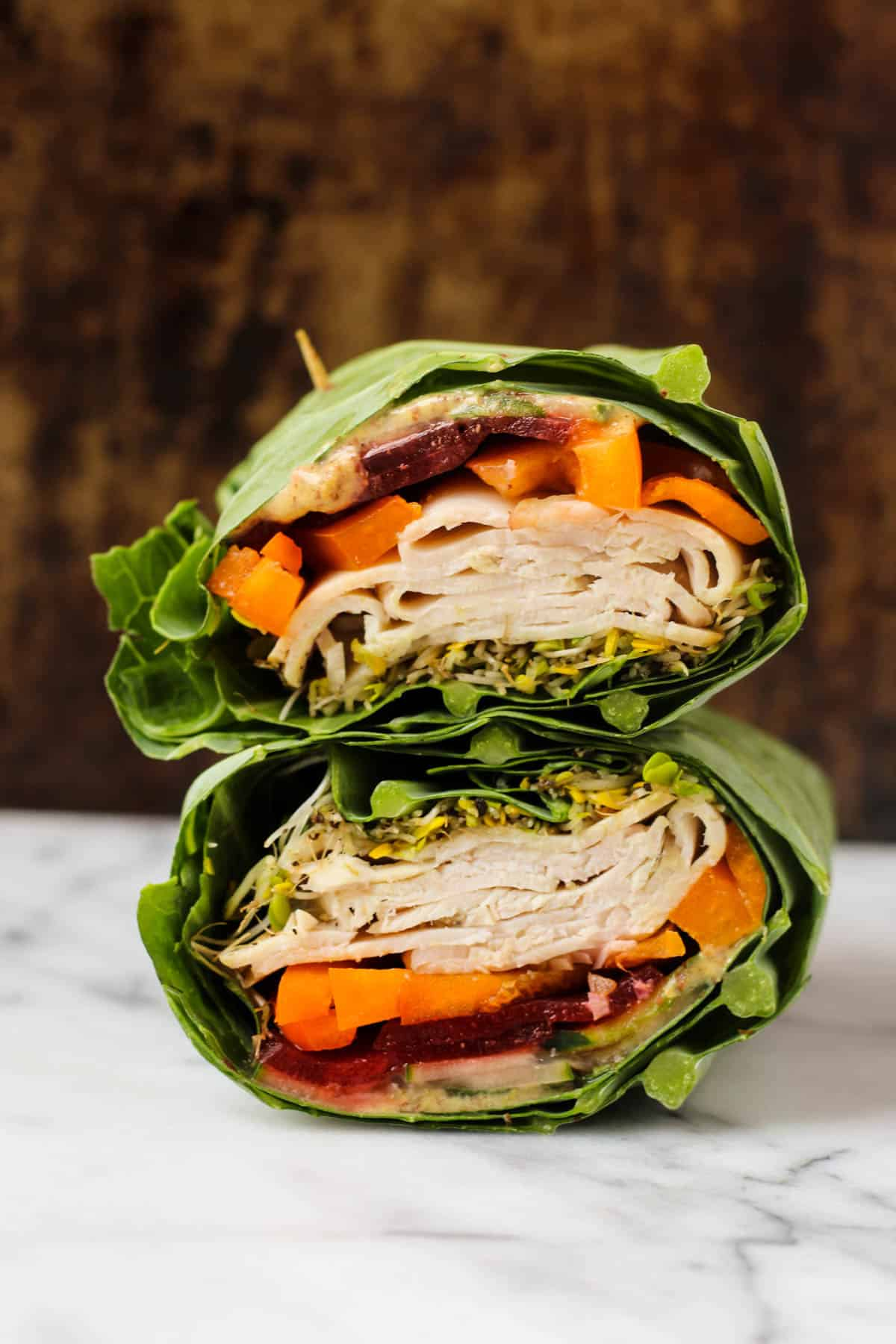 Use collard greens as a low carb and nutrient packed wrap! These Turkey Collard Wraps are customizable to your liking and paleo and Whole30 approved! - Eat the Gains