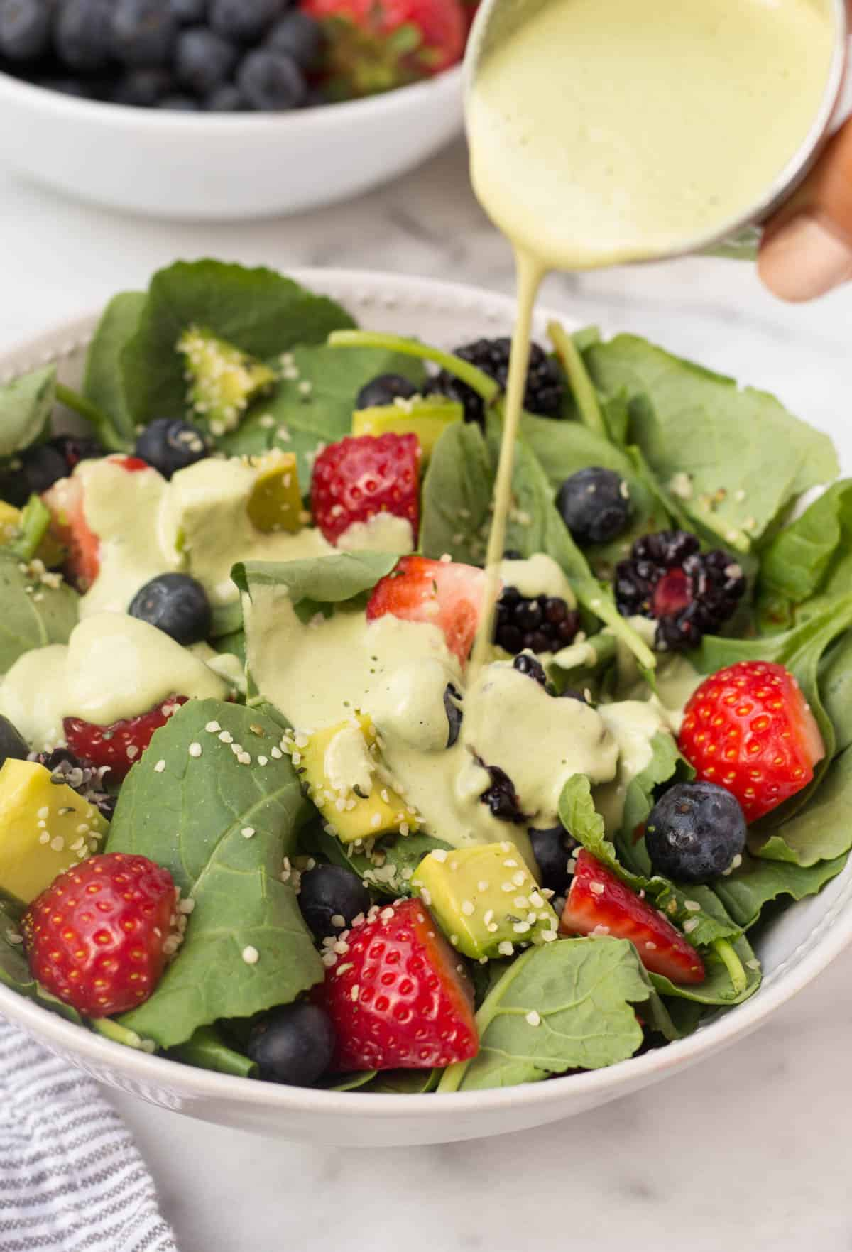 A perfect easy & light end of summer dish, this Berry Avocado Salad with Creamy Matcha Dressing packs the nutrients & is paleo, vegan, dairy free, & Whole30 approved! - Eat the Gains