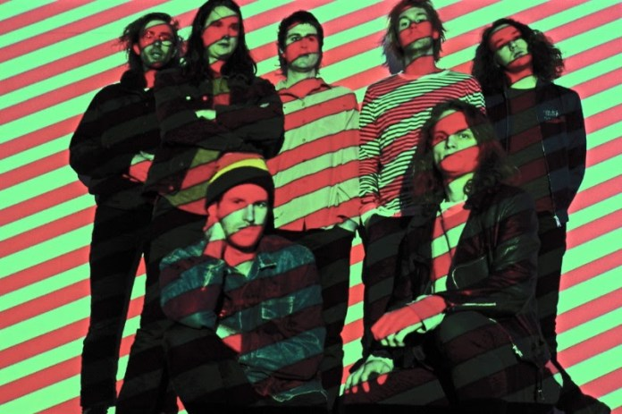 King Gizzard & The Lizard Wizard is Stu Mackenzie, Joe Walker, Eric Moore, Ambrose Kenny-Smith, Lucas Skinner. Cook Craig, and Michael Cavanagh.