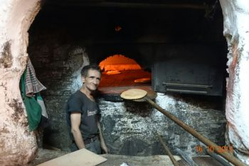 Baking bread for families who bring their own dough
