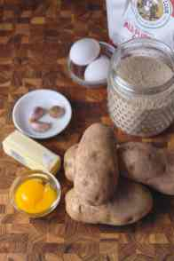 Potatoes, Garlic Butter, Nutmeg, Egg Yolks, Salt, and Pepper. Breaded in flour, egg, and breadcrumbs.