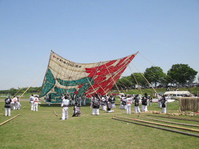 Staffs are making a giant kite lay down.