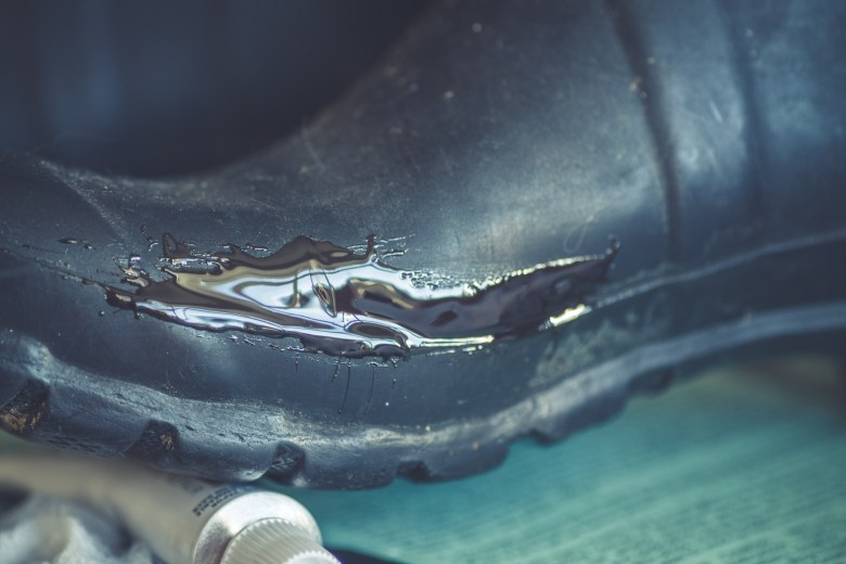 Patching a hole in Hunter boots.