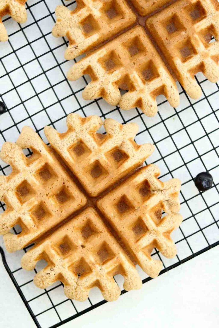 Fresh almond flour waffles cooling on a rack.