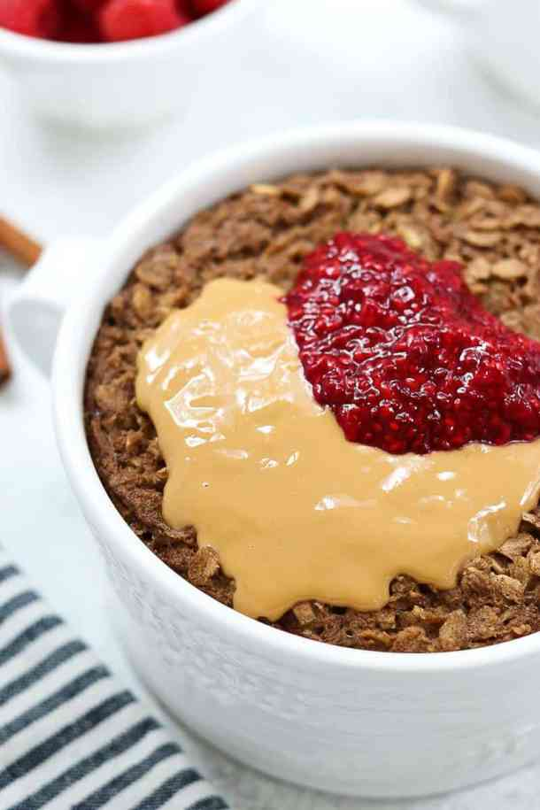 Up close image of baked oatmeal with melty peanut butter on top.