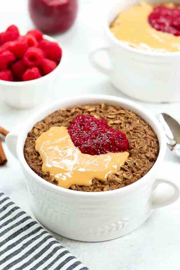 Healthy baked oatmeal recipe with peanut butter and jam on top.