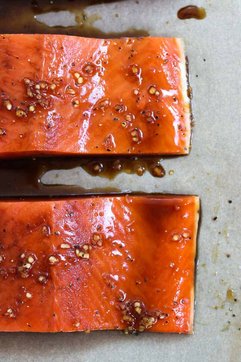 Two pieces of salmon with the glaze before going in the oven.