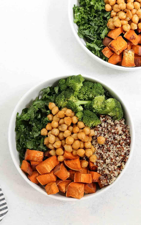 Kale, sweet potato, quinoa, broccoli and chickpeas in a buddha bowl.