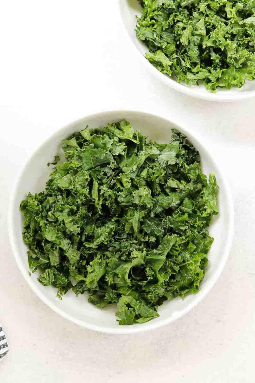 Chopped kale in two white bowls.