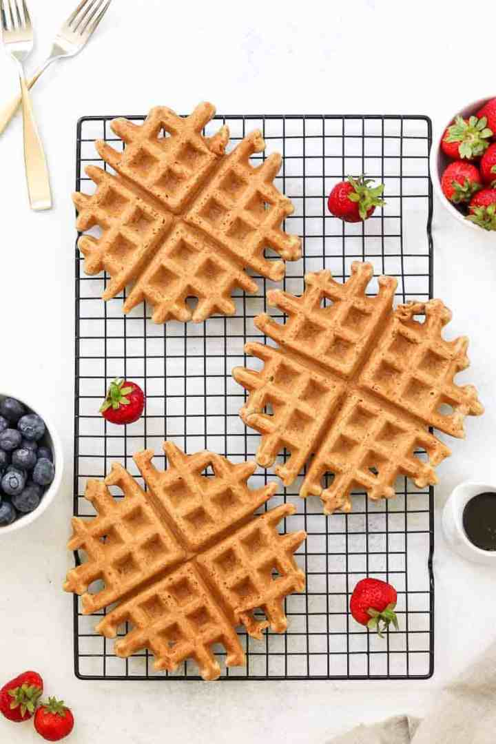 Vegan belgian waffles on a cooling rack.