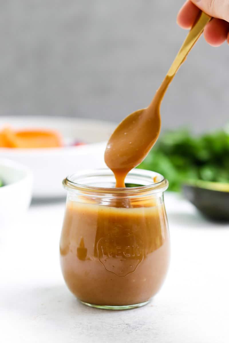 Peanut sauce in a small glass jar.