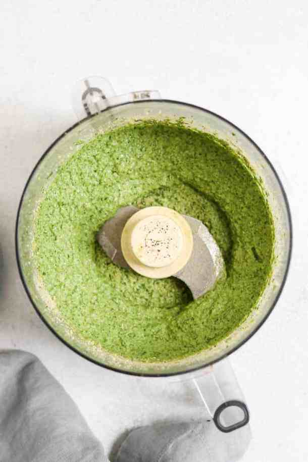 Dairy free pesto sauce in a food processor.