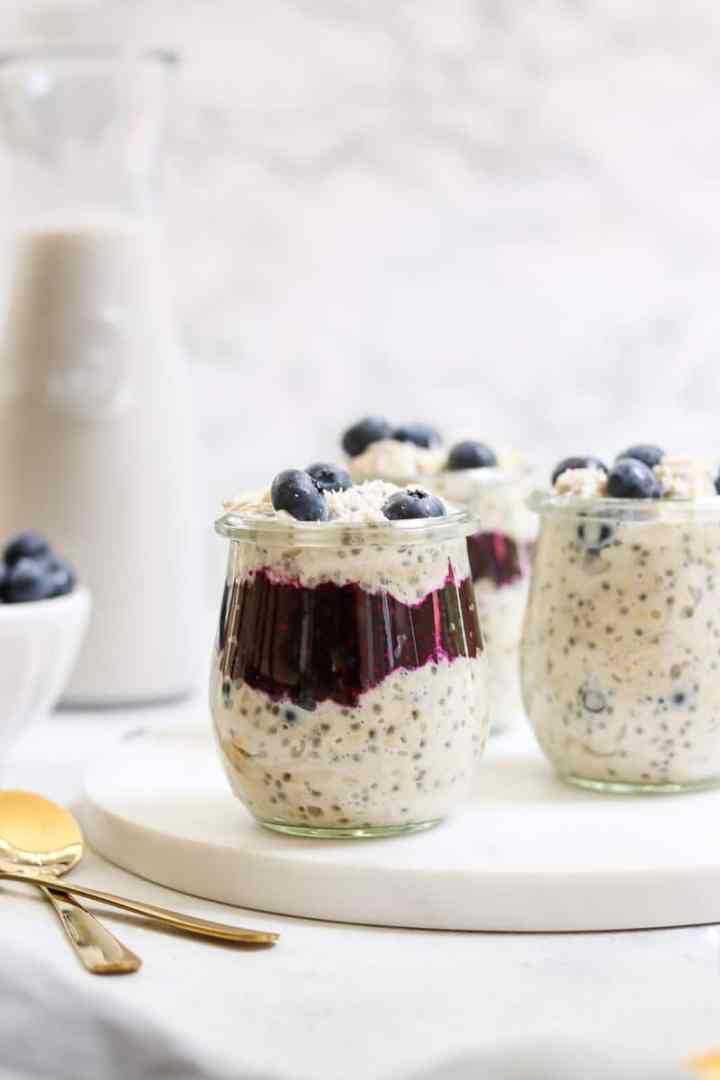Three jars with blueberry overnight oats.