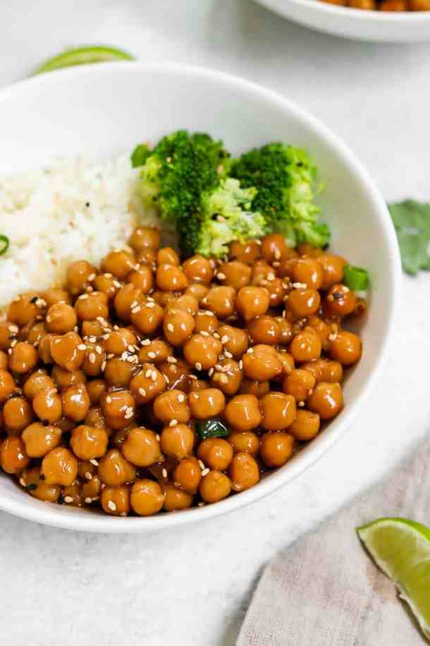 Sesame chickpeas in a white bowl with sesame seeds.