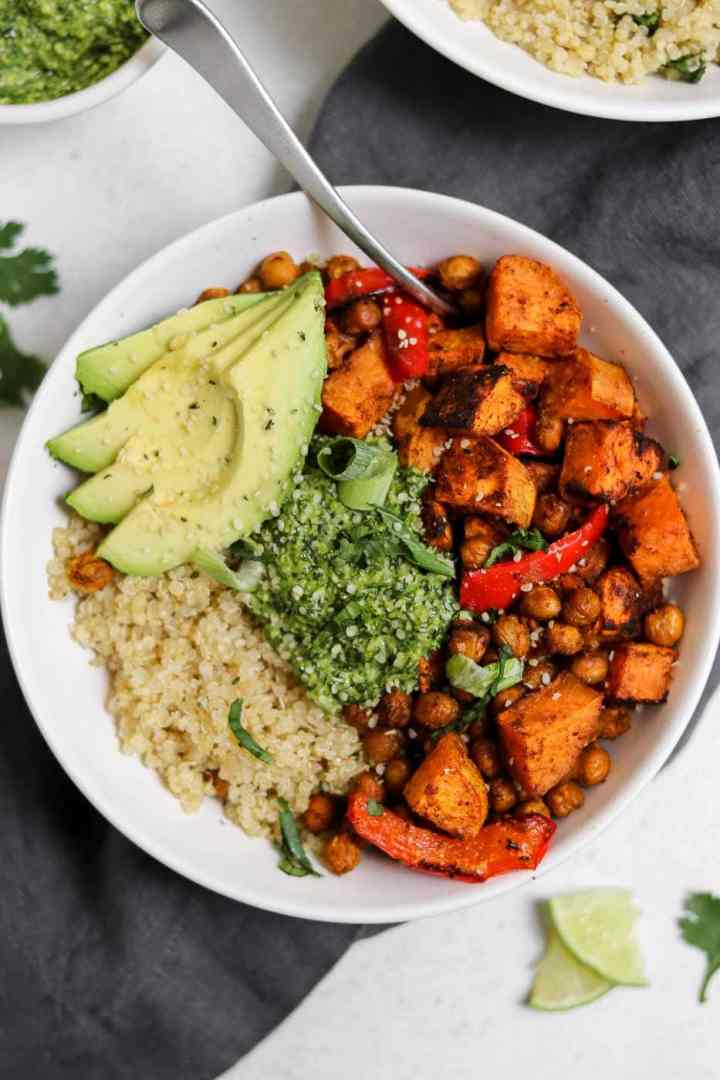 Vegan buddha bowl with sweet potato, chickpeas, and peppers.