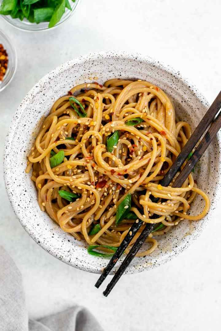 Noodles with chopsticks on the side.