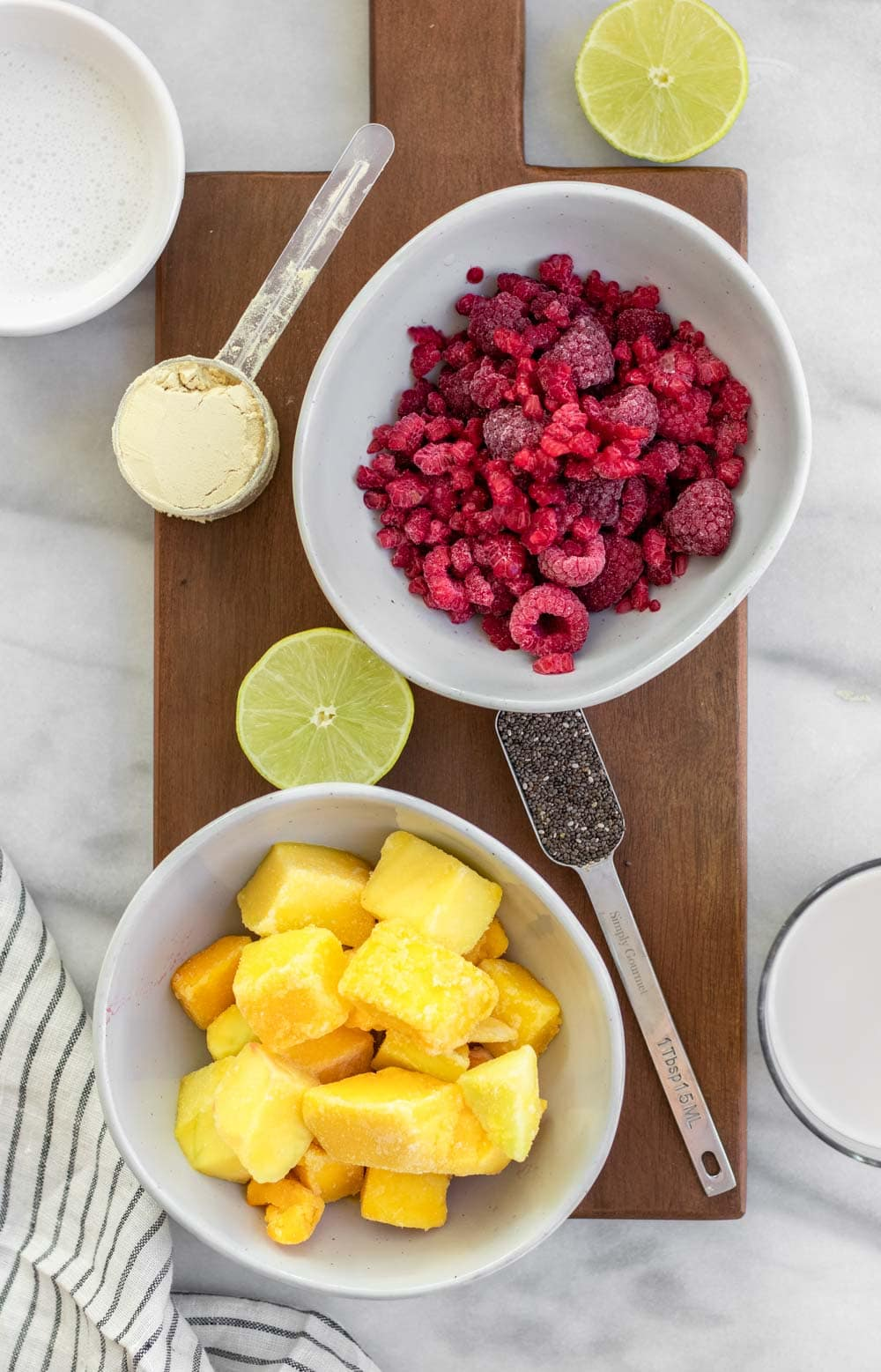 Ingredients for the smoothie arranged in bowls.