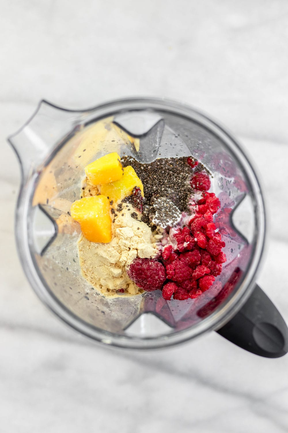 Ingredients for the smoothie in a blender.